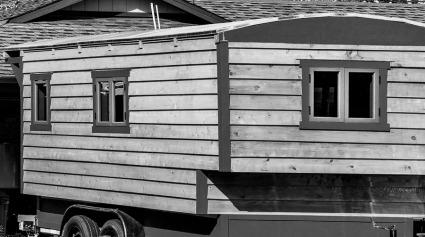 A homemade wood RV trailer.