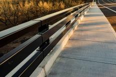Sidewalk and Railing along Highway.