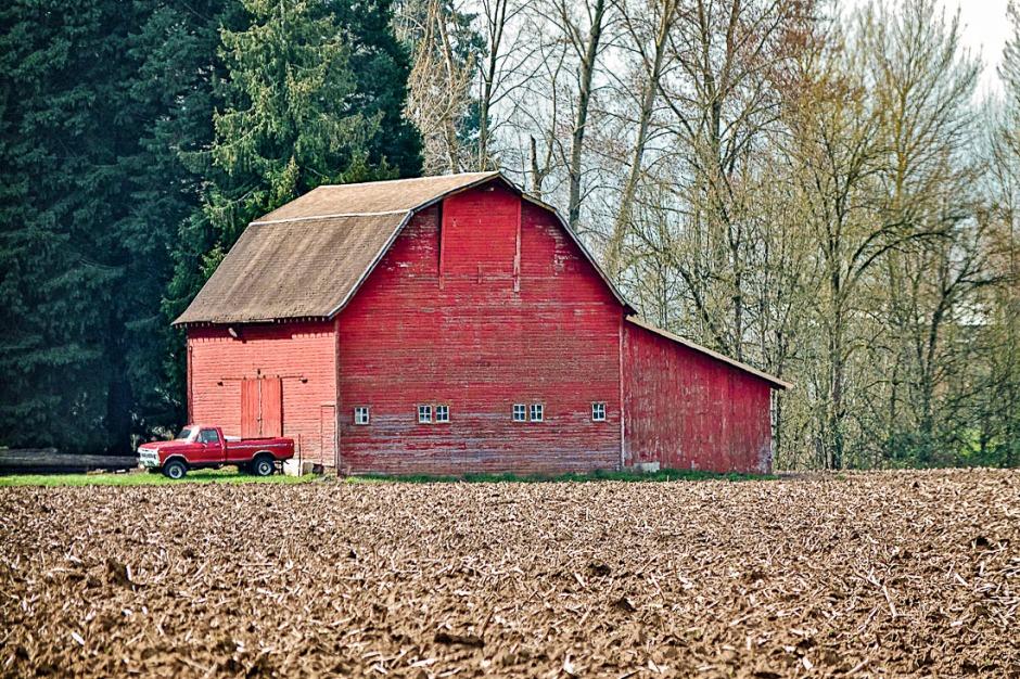 Barn and plowed field.