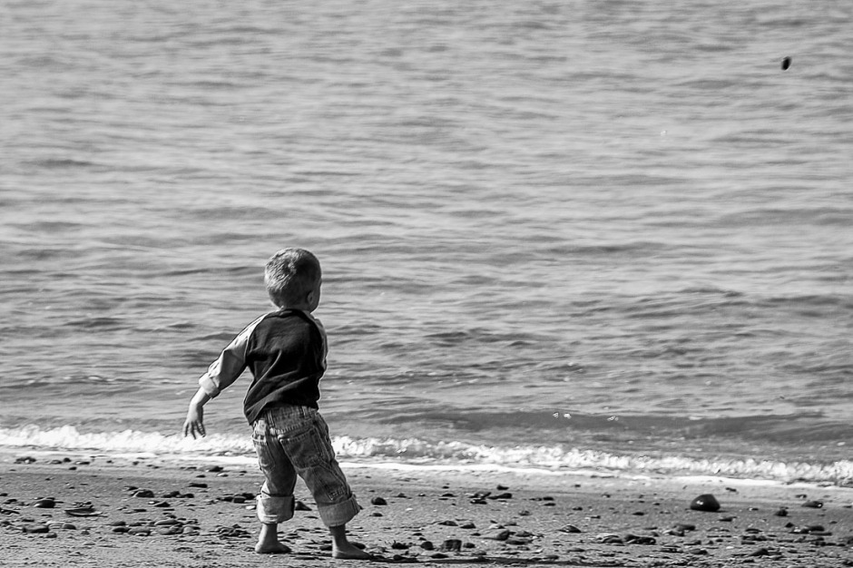 Children being themselves or in this case throwing stones in the ocean always makes me happy to watch.