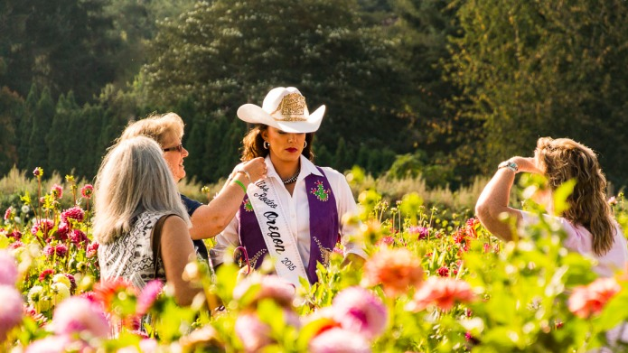 A candid capture of Miss Rodeo Oregon 2014 Oregon Photoshoot at Swan Island Dahlias.
