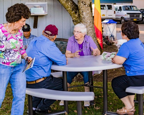 Margaret Gitts (in purple) talking to some people at Swan Island Dahlias in 2013.
