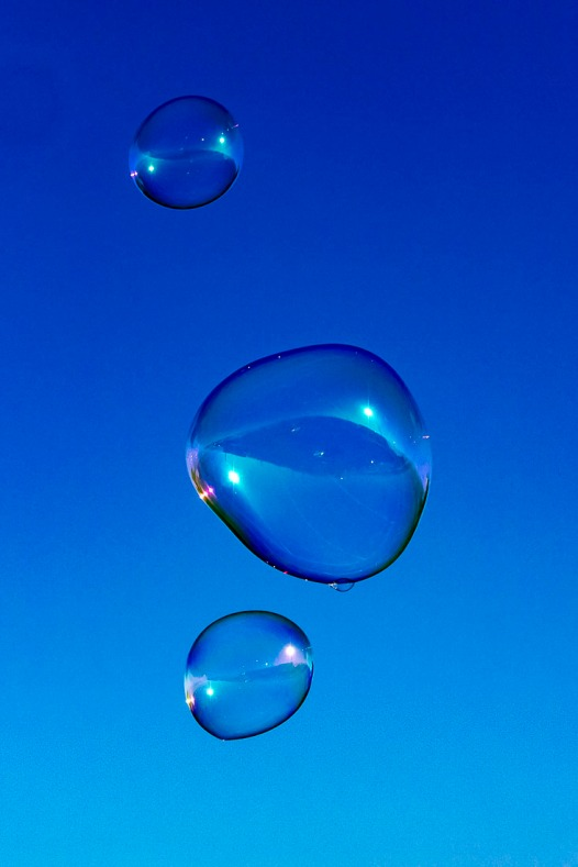 Giant bubbles against a blue morning sky.