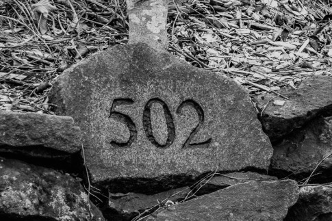 Carved address in rock.