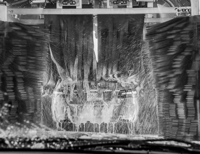Looking through a windshield before entering a car wash.