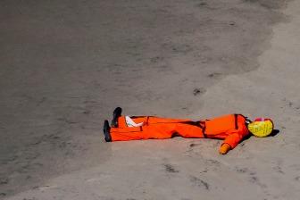 A test dummy on the beach.