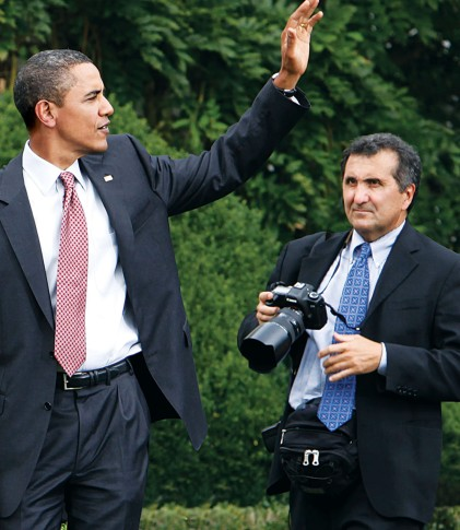 White House photographer Pete Souza, right, follows President Barack Obama at an event supporting Chicago's 2016 Olympic bid on the South Lawn of the White House in Washington, Wednesday, Sept. 16, 2009. (AP Photo/Charles Dharapak)