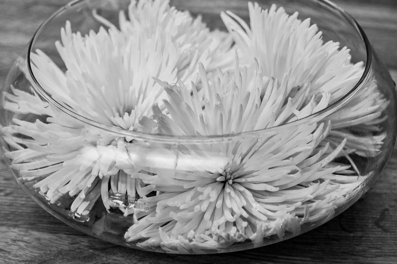 Chrysanthemums in a glass bowl.