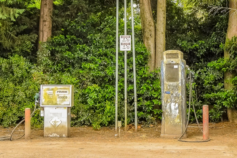 Vintage gas pump (on right) and much newer gas pump on left.
