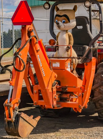 A stuffed animal on a construction site?