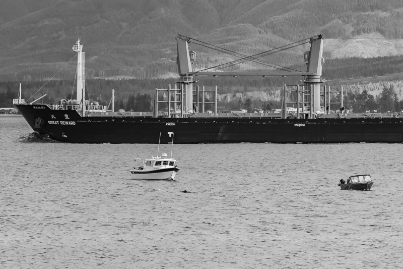 Small motor boat, not so small boat and some sort of ocean cargo ship. Photo taken on the Columbia River, Fort Stevens, Oregon.