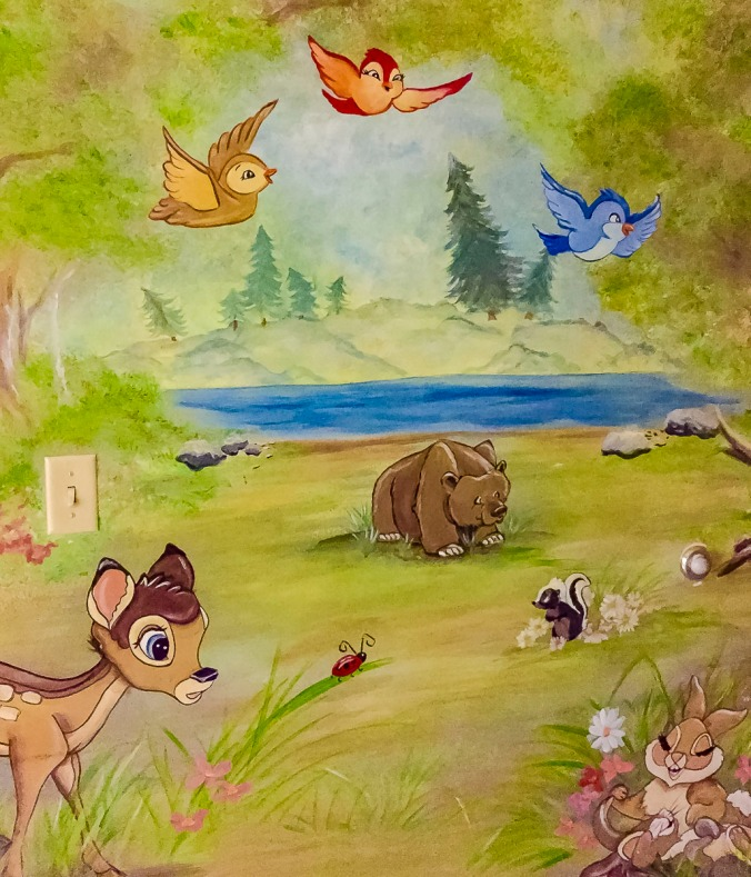Lady bug crawling under birds on the Bambi mural in the pediatric rooms at the hospital where I work.