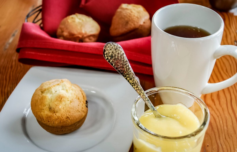 Coffee and muffins with lemon curd.