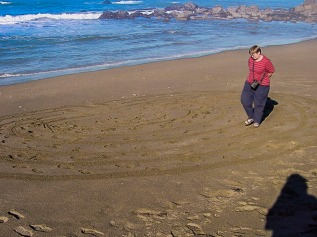 Took this photo of Chris walking a labyrinth she made on the beach in Crescent City, California back in September 14, 2003.
