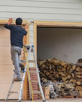 Fixing the frame of the garage door.
