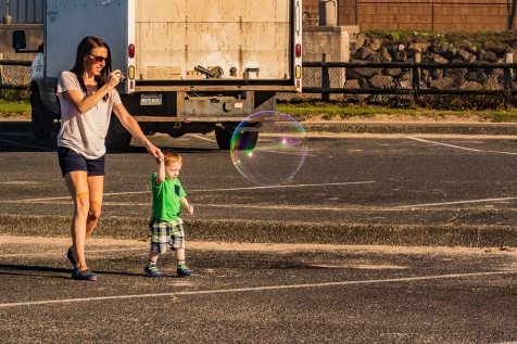 Mother and child chasing a bubble